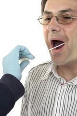 police detective or forensic scientist takes dna sample swab
