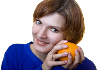 a photo of a girl with fresh orange in hands
