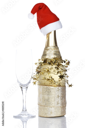 Champagne bottle hat reflected on white. Shallow DOF