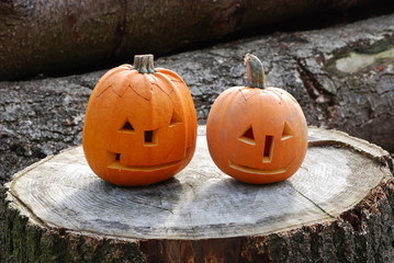 Halloween pumpkins ready for trick-or-treat placed in nature