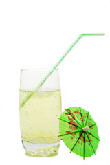 Fizzy drink with straw and cocktail umbrella