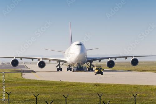Leinwanddruck Bild Flugzeug auf Rollbahn