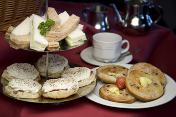 An arrangement of sandwiches and scones for afternoon tea