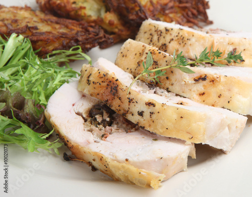 Roast chicken breast with potato rosti and salad