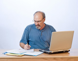 A businessman takes notes from the computer search results. poster