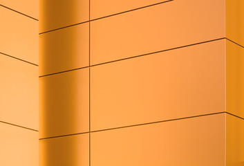 Glowing copper panels on a side of a modern building