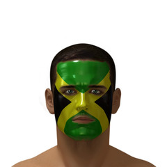 Portrait of a male with a Jamaican flag painted on his face.