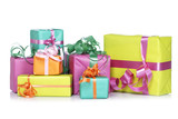 Gift boxes, reflected on white background. Shallow DOF