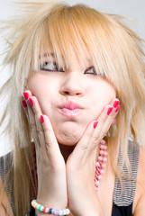 Emo girl blowing cheeks