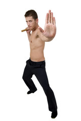 young person holding nunchaku warning to stop