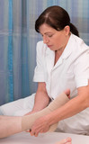 nurse bandaging foot and ankle poster