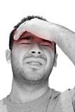 A young man grasping his head - a killer headache or migraine. poster