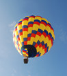 Brightly colored hot air balloon in early morning