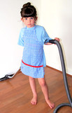 Child Vacuuming with Apron on poster