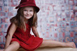 Little cute girl in red dress with big smile.