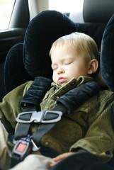 Sleeping boy in car seat