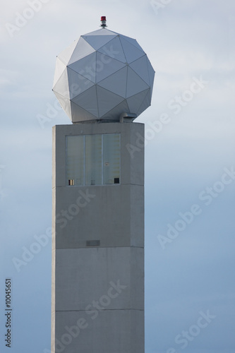 Doppler radar tower ball over blue sky with clipping path