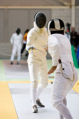 Two fencers practising their sport