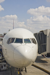 Nose of a commercial jetliner at the boarding gate