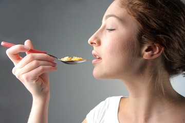 beautiful woman eating cornflakes