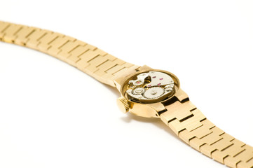 Gold watch isolated on white with mechanical parts inside