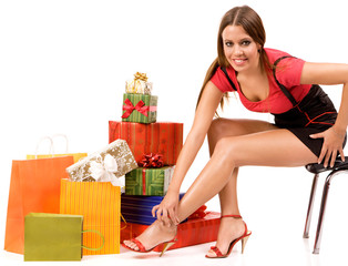 Attractive woman with many gift boxes and bags