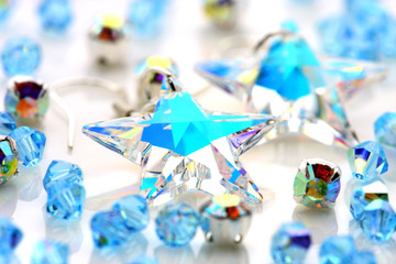 Transparent star shape earrings put together with beads.