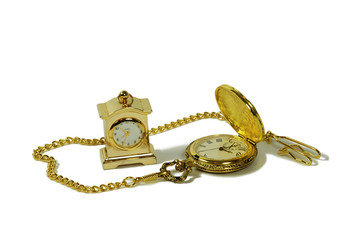 Gold pocket watch with a metal chain and small gold clock