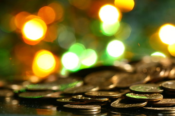 coins and colored  bokeh on background