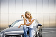 Young woman holding keys to new car