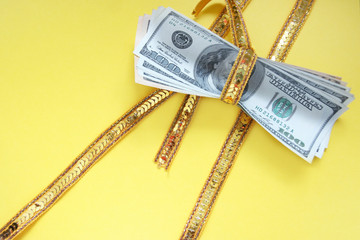 Very expensive gift - a heap of money tied up by a ribbon