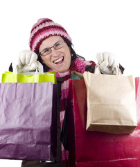 Consumerist Christmas girl with bags in a shopping day