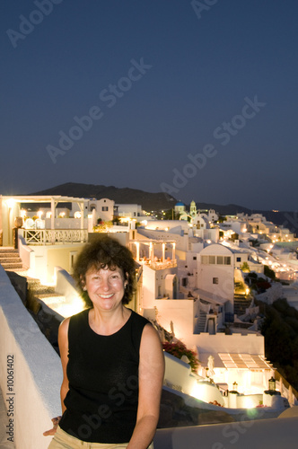 female tourist santorini night oia cyclades island architecture