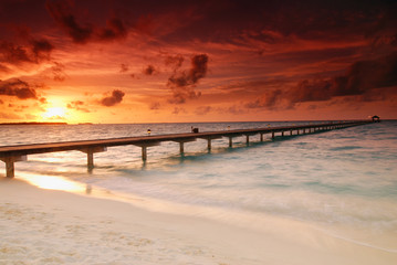 Gorgeous sunset over the sea and a jetty in the Caribbean