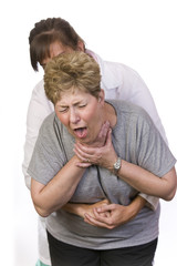Using the Heimlich Maneuver on a choking person