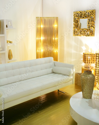 modern interior designed with golden accessories