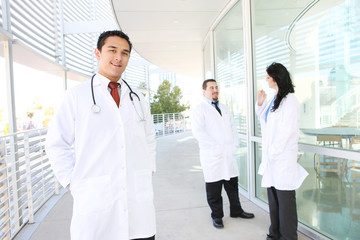 A happy and successful doctor outside hospital building
