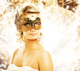 Beautiful woman in carnival mask over abstract background