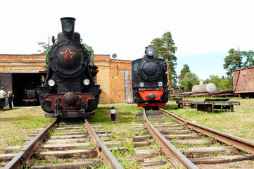 Two russian black steam locomotives
