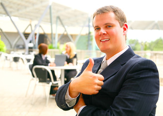 businessman giving ok sign or thumb up happy