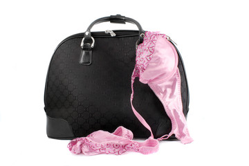 small suitcase with sexy lingerie hanging