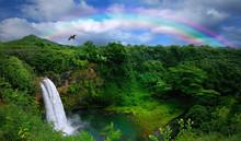 """Постер, картина, фотообои """"Waterfall in Kauai With Rainbow and Bird Overhead"""""""