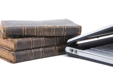 legal concept with modern laptop and old books