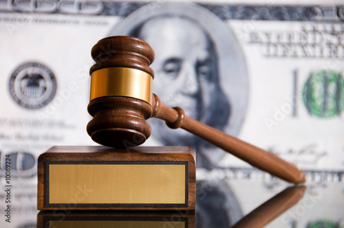Wooden justice gavel and block with brass