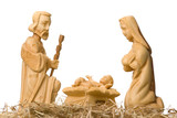 Fototapety Wooden figures of Mary and Joseph watching baby Jesus