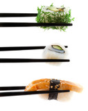 Sushi with chopsticks shot on white.