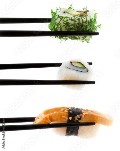 Sushi with chopsticks shot on white.