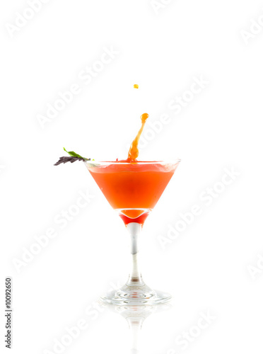 Cocktail drink on splash/ isolated