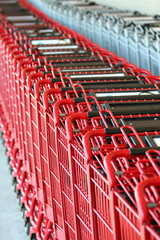 A Row of red metal shopping carts