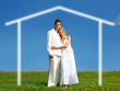 Young love couple smiling under blue sky.  Real estate concept.
